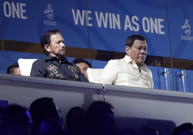 Brunei's Sultan Hassanal Bolkiah, left, sits beside Philippine President Rodrigo Duterte during the opening ceremony of the 30th South East Asian Games at the Philippine Arena, Bulacan province, northern Philippines on Saturday, Nov. 30, 2019. (AP Photo/Aaron Favila)