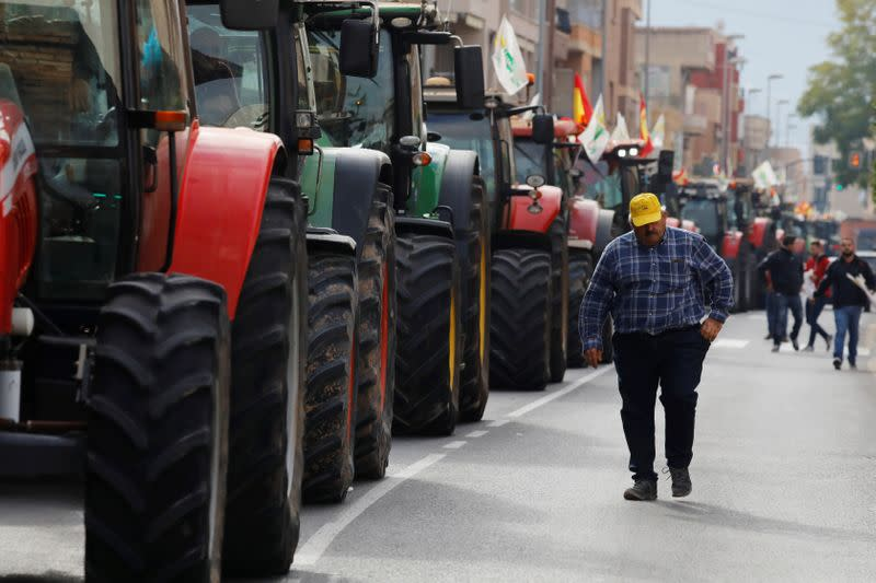 Tractors block a street during a protest of Spanish farmers and ranchers against low tariffs and distribution costs in the agriculture sector in Murcia