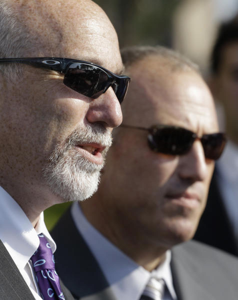 FILE - In a July 23, 2012 file photo, Joel Brodsky, left, lead defense attorney for former Bolingbrook police officer Drew Peterson, speaks to reporters accompanied by attorney Steve Greenberg before going into court for the first day of jury selection in Peterson's murder trial in Joliet, Ill. Peterson, 58, is charged with killing his third wife, Kathleen Savio, in 2004. Opening statements are scheduled to begin Tuesday, July 31. (AP Photo/M. Spencer Green, File)