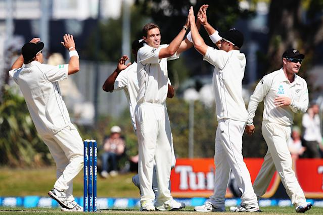 DUNEDIN, NEW ZEALAND - DECEMBER 05: Tim Southee of New Zealand celebrates the wicket of Marlon Samuels of the West Indies during day three of the first test match between New Zealand and the West Indies at University Oval on December 5, 2013 in Dunedin, New Zealand. (Photo by Hannah Johnston/Getty Images)