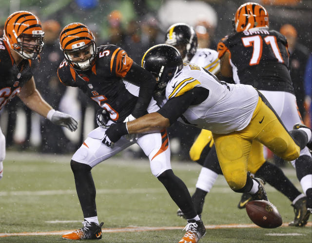 FILE - In this Jan. 9, 2016, file photo, Cincinnati Bengals quarterback AJ McCarron (5) fumbles after being hit by Pittsburgh Steelers' Cameron Heyward (97) during the first half of an NFL wild-card playoff football game, in Cincinnati. With their first playoff victory since 1990 seemingly secured, the Bengals went into one of the biggest meltdowns in NFL history and lost to the Steelers, ending their 2015 season. It was the start of six straight losses to their AFC North rival, a stretch of futility that they cant avoid as they get ready to meet again. (AP Photo/Gary Landers, File)