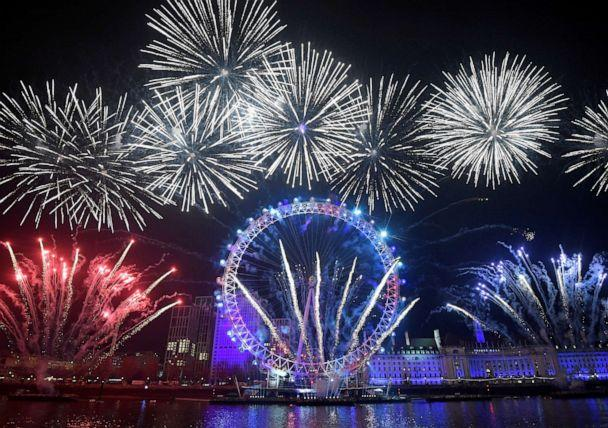 PHOTO: Fireworks explode around the London Eye wheel during New Year celebrations in central London, Britain, January 1, 2020. (Toby Melville/Reuters)