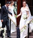 """<p>Emmy Rossum wore an off-the-shoulder House of Herrera (by Carolina Herrera) dress to marry Sam Esmail in New York City. Guests included Rossum's Shameless co-star William H. Macy, Mr. Robot actor Rami Malek, and Hilary Swank<span class=""""redactor-invisible-space"""">.</span></p>"""