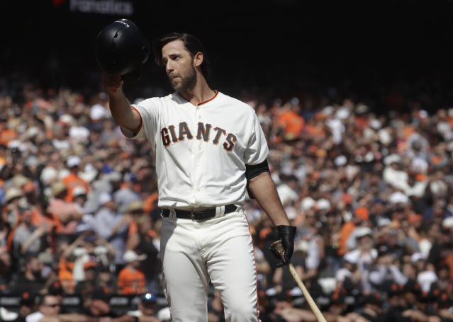 FILE - In this Sunday, Sept. 29, 2019, file photo, San Francisco Giants' Madison Bumgarner waves toward fans before pinch hitting against the Los Angeles Dodgers during the fifth inning of a baseball game in San Francisco. The Giants plan to meet with the free agent left-handers representatives during the December 2019 baseball winter meetings in San Diego. (AP Photo/Jeff Chiu, File)