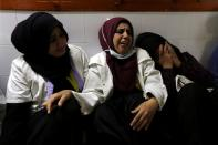 FILE PHOTO: Colleagues of Palestinian nurse Razan Al-Najar, who was killed during a protest at the Israel-Gaza border, react at a hospital in the southern Gaza Strip