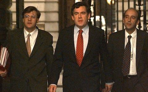 Gabriel Makhlouf accompanies Gordon Brown from the Treasury in the late 1990s - Credit: Eddie Mulholland