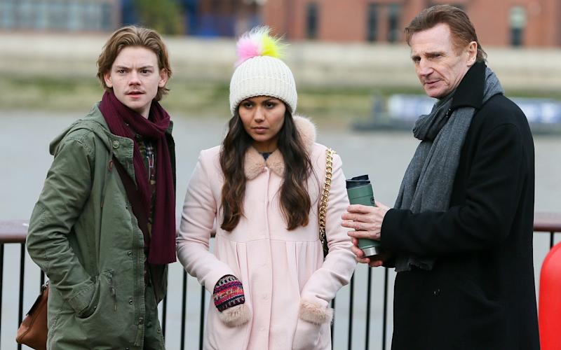 Liam Neeson reunites with his on screen son Thomas Brodie-Sangster and Olivia Olsen while filming Love Actually 2 for Comic Relief - Credit: The Mega Agency