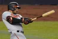 Baltimore Orioles' Anthony Santander follows through on a fourth-inning solo home run off New York Yankees starting pitcher Jameson Taillon in a baseball game Wednesday, April 7, 2021, at Yankee Stadium in New York. (AP Photo/Kathy Willens)