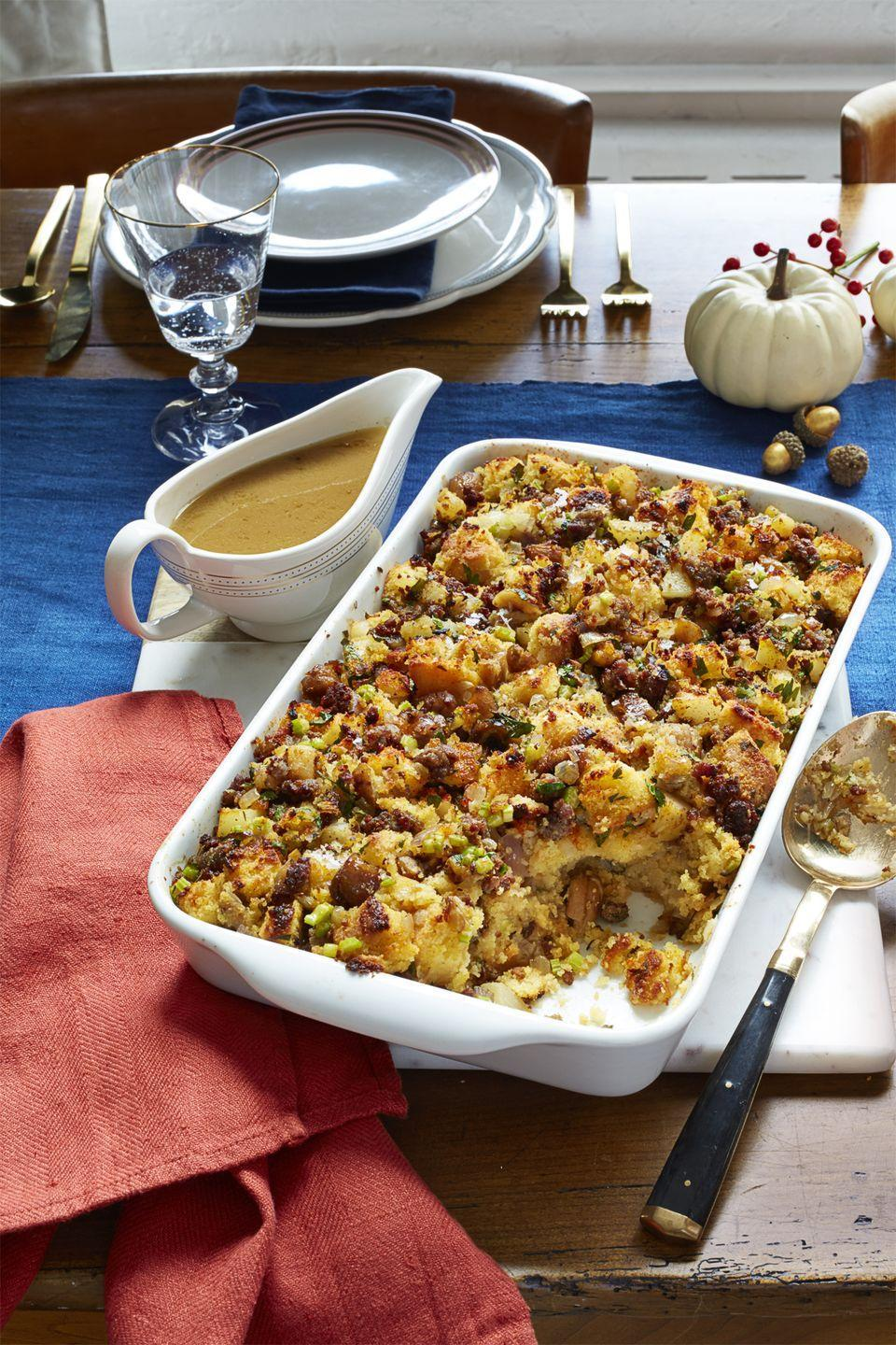 """<p>Serve up a sophisticated, Southern side dish this Thanksgiving with this flavorful stuffing.<br></p><p><em><a href=""""https://www.womansday.com/food-recipes/food-drinks/recipes/a56465/cornbread-sausage-and-chestnut-stuffing-recipe/"""" rel=""""nofollow noopener"""" target=""""_blank"""" data-ylk=""""slk:Get the Cornbread, Sausage, and Chestnut Stuffing recipe."""" class=""""link rapid-noclick-resp""""><strong>Get the Cornbread, Sausage, and Chestnut Stuffing recipe.</strong></a> </em></p>"""