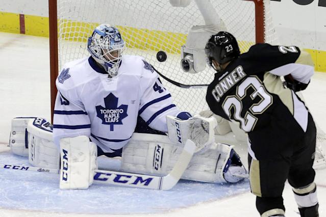 Pittsburgh Penguins' Chris Conner (23) lifts the puck over Toronto Maple Leafs goalie Jonathan Bernier for a first-period goal during an NHL hockey game in Pittsburgh, Wednesday, Nov. 27, 2013. (AP Photo/Gene J. Puskar)