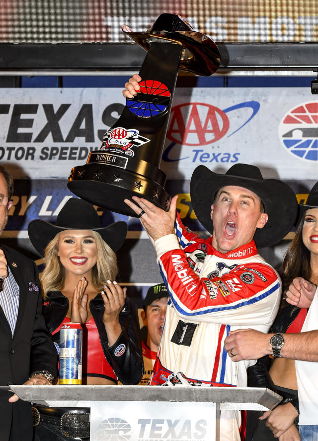 Kevin Harvick celebrates in Victory Lane after winning a NASCAR Cup auto race at Texas Motor Speedway, Sunday, Nov. 4, 2018, in Fort Worth, Texas. (AP Photo/Larry Papke)