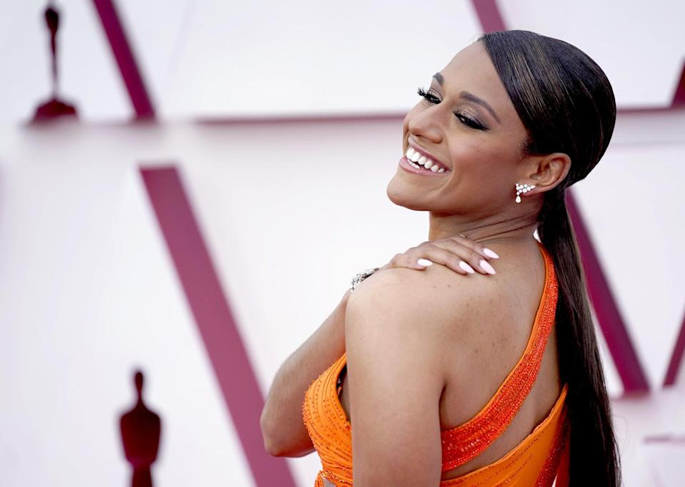 """<p>Ariana DeBose's sleek low ponytail by celebrity hairstylist <a href=""""https://www.instagram.com/peterluxhair/"""" class=""""link rapid-noclick-resp"""" rel=""""nofollow noopener"""" target=""""_blank"""" data-ylk=""""slk:Peter Luxe"""">Peter Luxe</a> and neutral, oval-shaped manicure complemented her bright orange dress.</p>"""