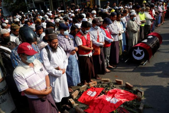 People attend the funeral of a woman who was shot dead during an anti-coup demonstration in Mandalay