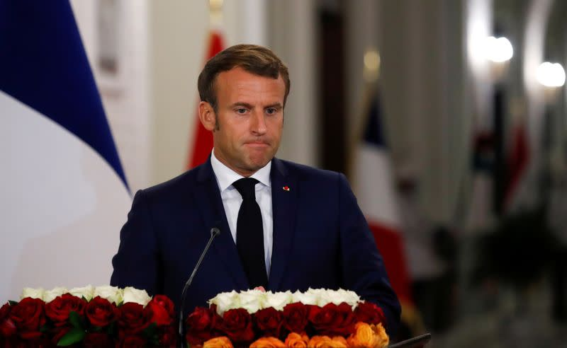 To be French is to defend the right to mock, Macron tells new citizens