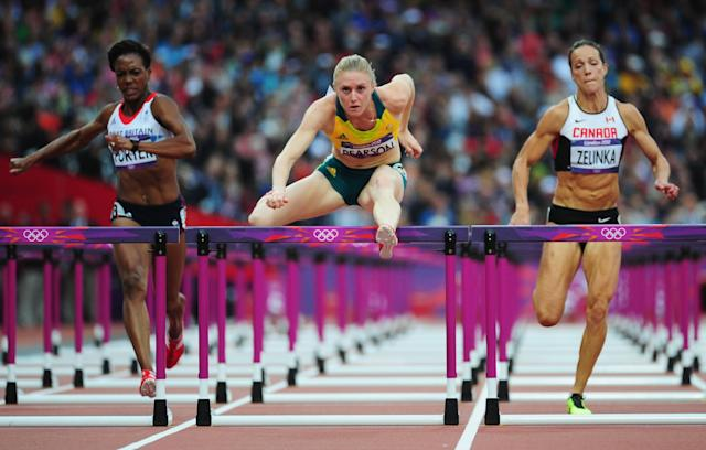LONDON, ENGLAND - AUGUST 07: Sally Pearson of Australia leads Tiffany Porter of Great Britain and Jessica Zelinka of Canada in the Women's 100m Hurdles Semifinals on Day 11 of the London 2012 Olympic Games at Olympic Stadium on August 7, 2012 in London, England. (Photo by Stu Forster/Getty Images)