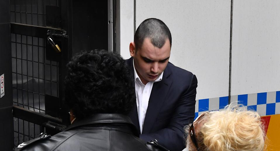 Photo shows Mathew Flame arriving at a Sydney courtroom.
