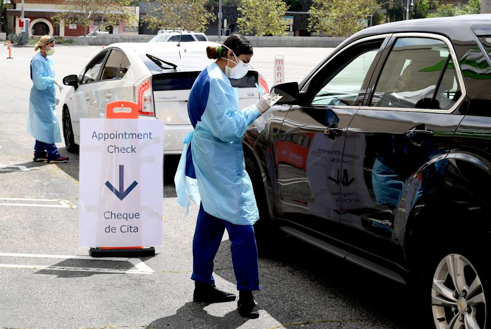 Drive-through coronavirus testing sites have sprung up in the United States. (Photo by Kevin Winter/Getty Images)