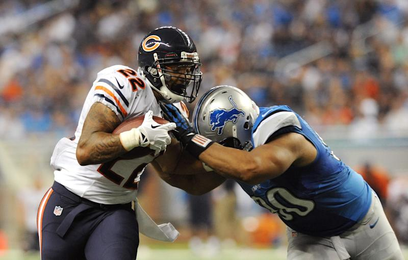 Chicago Bears running back Matt Forte (22) is stopped by Detroit Lions defensive tackle Ndamukong Suh (90) during the third quarter of an NFL football game at Ford Field in Detroit, Sunday, Sept. 29, 2013. (AP Photo/Jose Juarez)