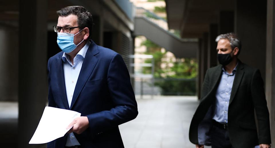 Victoria's Premier Daniel Andrews (left) and Chief Health Officer Brett Sutton (right) arrive for the press conference on August 17, 2021 in Melbourne.