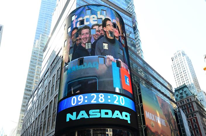 Facebook co-founder Mark Zuckerberg is seen on a screen getting ready to ring the NASDAQ stock exchange opening bell in Times Square in New York, 18 May 2012. Photo: Emmanuel Dunand/AFP via Getty Images