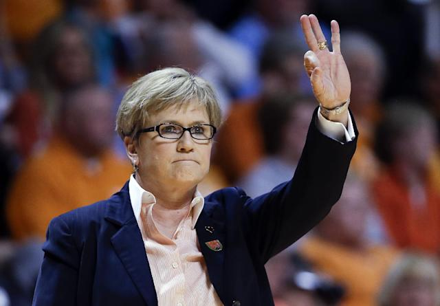 Tennessee head coach Holly Warlick signals to her players in the first half of an NCAA women's college basketball second-round tournament game against St. John's Monday, March 24, 2014, in Knoxville, Tenn. (AP Photo/Mark Humphrey)