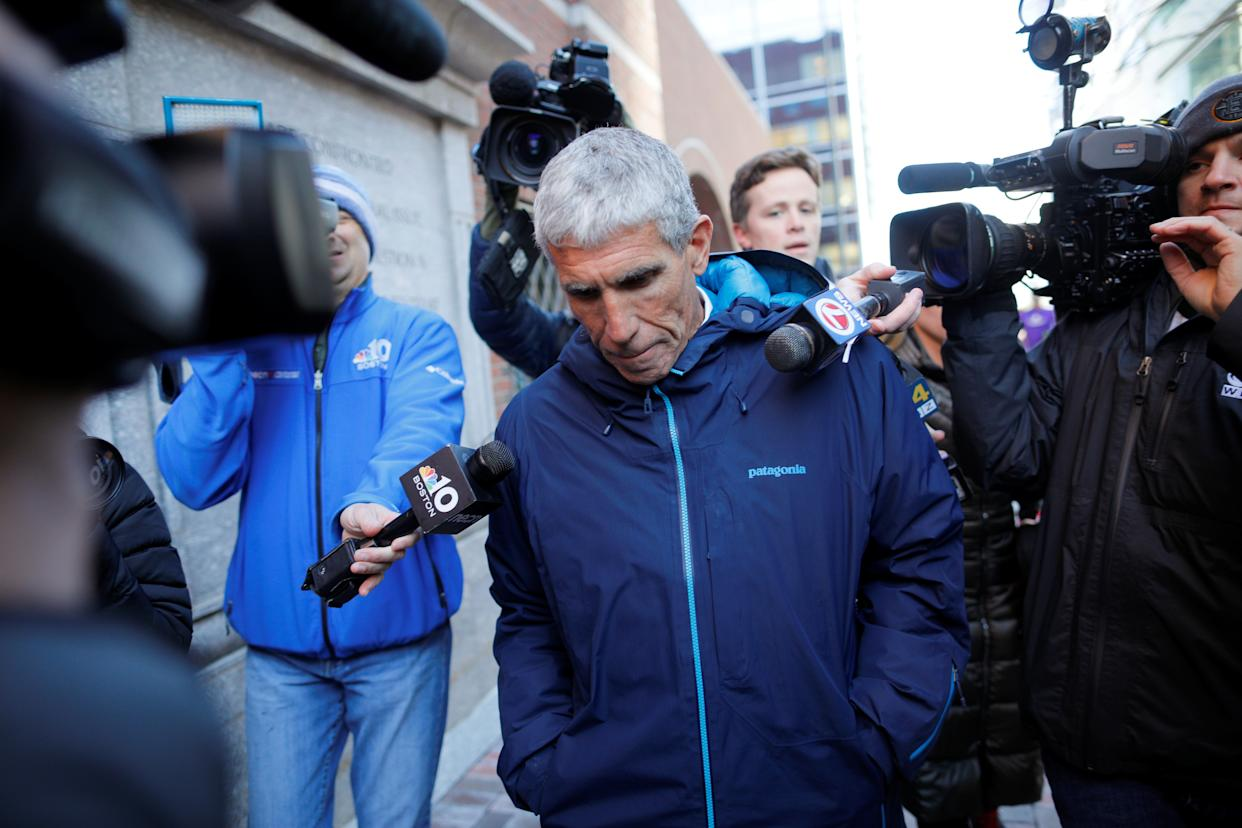 """William """"Rick"""" Singer leaves the federal courthouse after facing charges in a nationwide college admissions cheating scheme in Boston, Massachusetts, U.S., March 12, 2019.   REUTERS/Brian Snyder"""