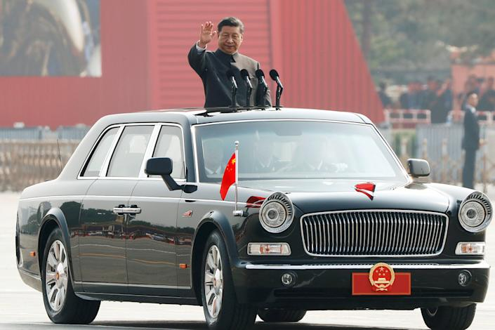 Chinese President Xi Jinping waves from a vehicle as he reviews the troops at a military parade marking the 70th founding anniversary of People's Republic of China, on its National Day in Beijing, China October 1, 2019. (Photo: Thomas Peter/Reuters)