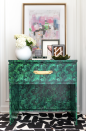 "<p>Jewel Marlowe of <a href=""https://jeweledinteriors.com/2019/03/malachite-table-diy-ikea-hack-using-spoonflower-wallpaper/"" rel=""nofollow noopener"" target=""_blank"" data-ylk=""slk:Jeweled Interiors"" class=""link rapid-noclick-resp"">Jeweled Interiors</a> gave this side table an elegant look with <a href=""https://www.spoonflower.com/en/wallpaper/405800-malachite-2-by-ravynka"" rel=""nofollow noopener"" target=""_blank"" data-ylk=""slk:Malachite Wallpaper"" class=""link rapid-noclick-resp"">Malachite Wallpaper</a> from Spoonflower. It was previously just an unfinished set of wood drawers!</p>"