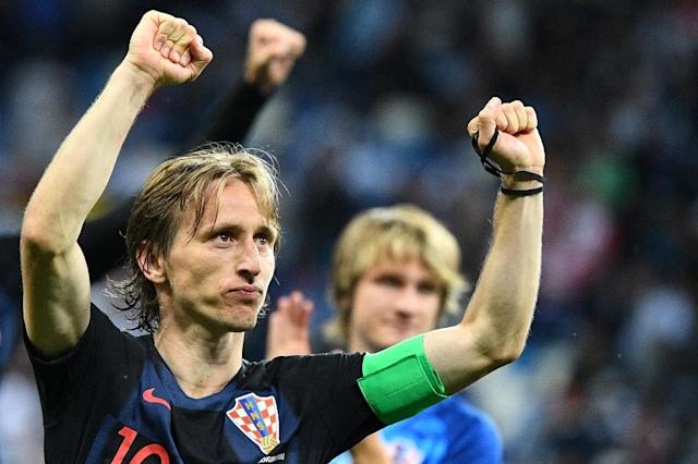 Croatia's star midfielder Luka Modric doesn't get the credit he deserves believes his Croatia teammate Dejan Loveren (AFP Photo/Johannes EISELE)