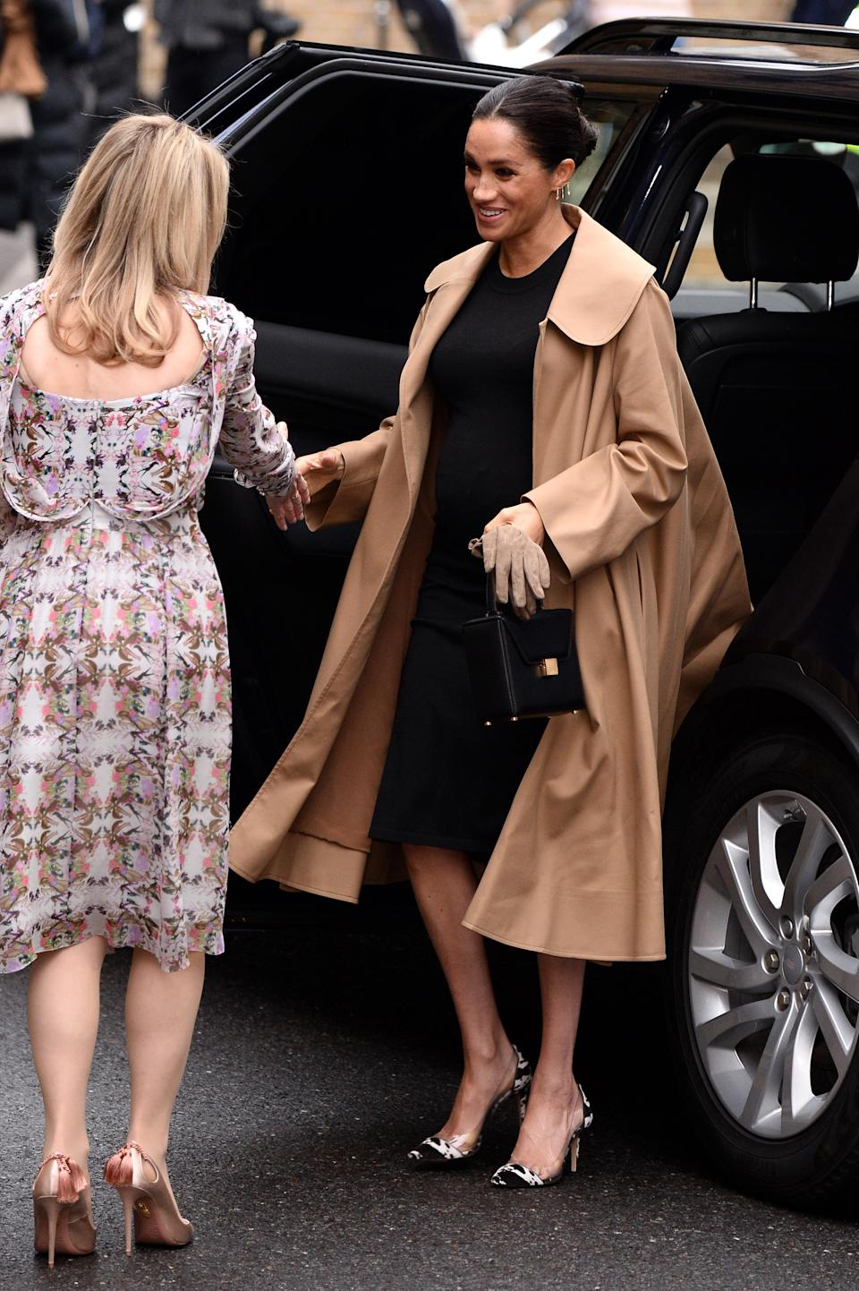 The Duchess of Sussex wore a chic ensemble to kick-start 2019, as she paid a visit to one of her first patronages Smart Works. The pregnant royal chose a £2,492 camel-hued Oscar de la Renta coat with a £170 black dress by US maternity label Hatch. [Photo: Getty]