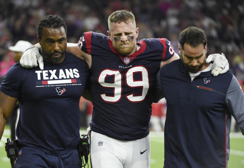 Houston Texans defensive end J.J. Watt (99) is helped off the field after he was injured during the first half against the Chiefs. (AP)