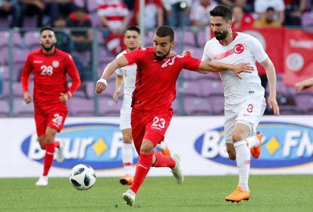 Tunisia's Naim Sliti in action with Turkey's Hasan Ali Kaldirim. REUTERS/Denis Balibouse