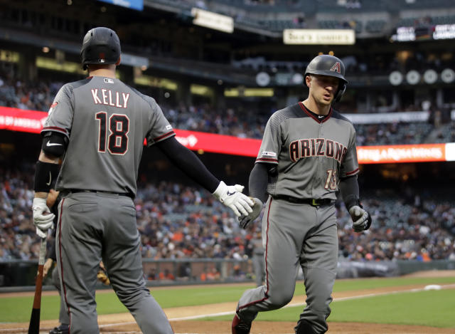 Arizona Diamondbacks' Nick Ahmed, right, is congratulated by Carson Kelly after hitting a home run off San Francisco Giants' Tyler Beede during the fifth inning of a baseball game Thursday, June 27, 2019, in San Francisco. (AP Photo/Ben Margot)