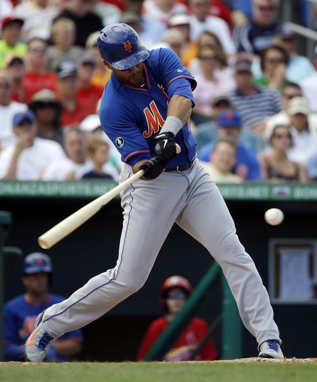 New York Mets' Cory Vaughn singles to score teammates Matt Clark and Anthony Recker in the sixth inning of an exhibition spring training baseball game against the St. Louis Cardinals, Sunday, March 16, 2014, in Jupiter, Fla. (AP Photo/David Goldman)