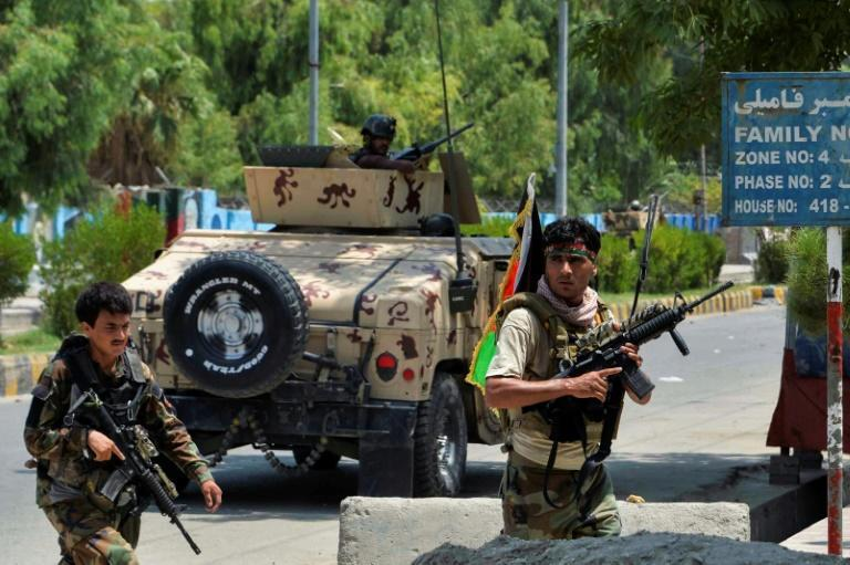 Afghan soldiers take up position outside a prison during a raid in Jalalabad in August