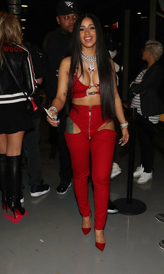 """<p>The rapper <a rel=""""nofollow"""" href=""""https://www.vogue.com/article/cardi-b-new-york-fashion-week-spring-2018"""">took New York Fashion Week by storm</a>, and continues to set trends by participating in this latest one. For her performance at Tidal X Brooklyn, Cardi rocked a red strappy bra with matching cutout pants. (Photo: Getty Images) </p>"""