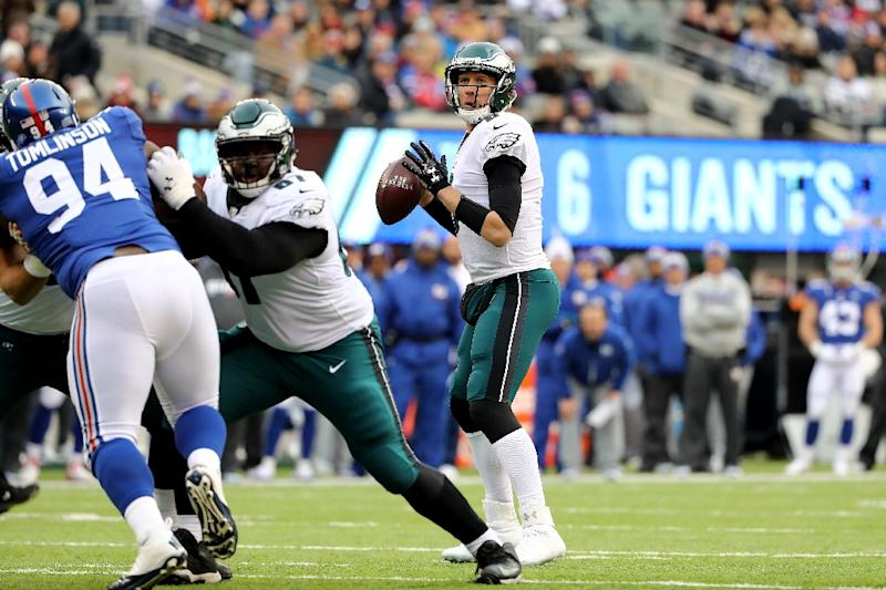 Nick Foles, standing in for injured Philadelphia quarterback Carson Wentz, threw four touchdown passes as the Eagles held off the New York Giants 34-29 to clinch a first-round bye (AFP Photo/ELSA)