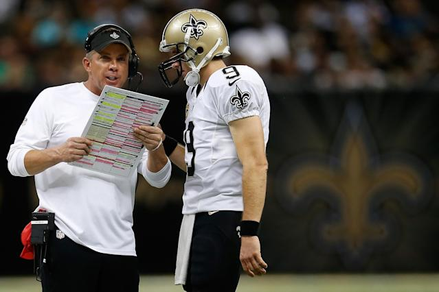 NEW ORLEANS, LA - SEPTEMBER 30: Head coach Sean Payton talks with Drew Brees #9 of the New Orleans Saints during a time out against the Miami Dolphins at the Mercedes-Benz Superdome on September 30, 2013 in New Orleans, Louisiana. (Photo by Chris Graythen/Getty Images)