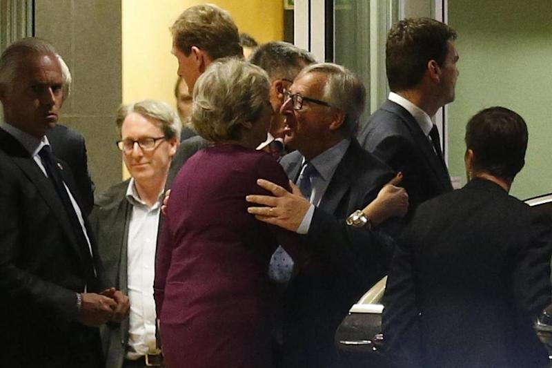 Prime Minister Theresa May is greeted by European Commission President Jean-Claude Juncker while leaving the European Commission headquarters (REUTERS)