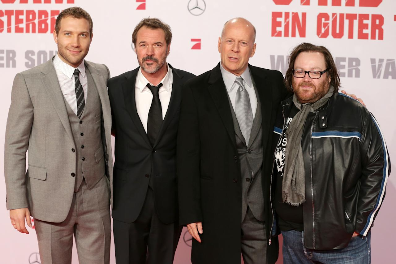 BERLIN, GERMANY - FEBRUARY 04:  (L-R) Jai Courtney, Sebastian Koch, Bruce Willis and John Moore attend 'Die Hard - Ein Guter Tag Zum Sterben' Germany Premiere at Cinestar Potsdamer Platz on February 4, 2013 in Berlin, Germany.  (Photo by Andreas Rentz/Getty Images)