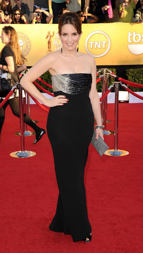 Tina Fey (in vintage Versace) arrives at the 18th Annual Screen Actors Guild Awards at The Shrine Auditorium in Los Angeles, California.