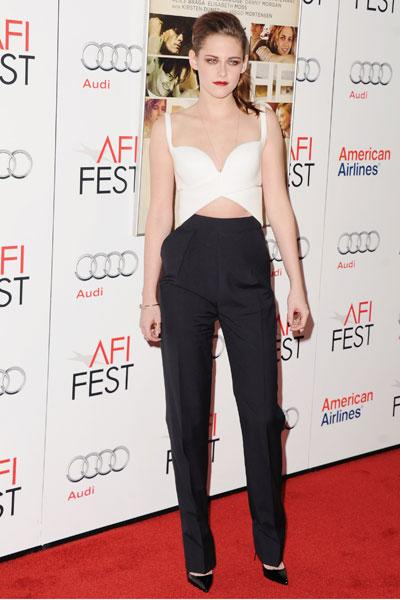 Kristen Stewart shows us once again that she is willing to take fashion risks in this daring ensemble featuring a low-cut, criss-cross crop top and high-waisted cigarette trousers. The 22-year-old wore the Balenciaga look (for whom she is a spokesperson for their new fragrance 'Florabotanica') at the AFI Presented by Audi screening of 'On the Road' in Hollywood, Nov. 3. (Photo by Jon Kopaloff/FilmMagic)