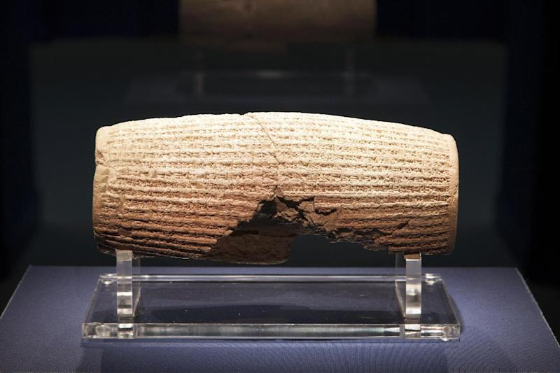 In this image provided by The Smithsonian Institution, the Cyrus Cylinder is seen on display at the Smithsonian's Freer Sackler Gallery in Washington. The 2,500-year-old Babylonian artifact sometimes described as the world's first human rights charter will be shown for the first time in the United States at the gallery, followed by stops in New York, Houston and Los Angeles. The British Museum is loaning the cylinder, which carries an account of how Persian king Cyrus conquered Babylon in 539 B.C. and restored people held captive to their homelands. (AP Photo/The Smithsonian Institution, John Tsantes)