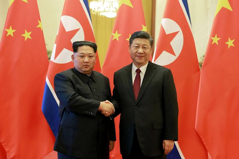 Kim (left) and Xi meeting in Beijing in March: a Japanese newspaper says a possible Xi visit to Pyongyang is now being discussed