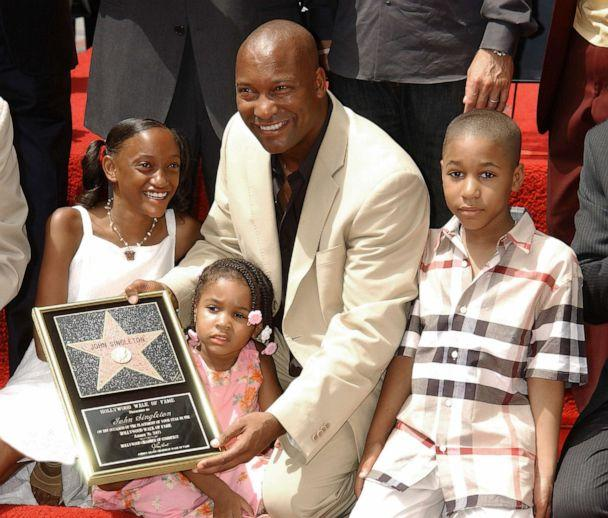 PHOTO: John Singleton with his children, Justice, Cleo and Massai during the ceremony honoring with a star on the Hollywood Walk of Fame, in Hollywood, Calif, Aug. 26, 2003. (Gregg Deguire/Getty Images, FILE)