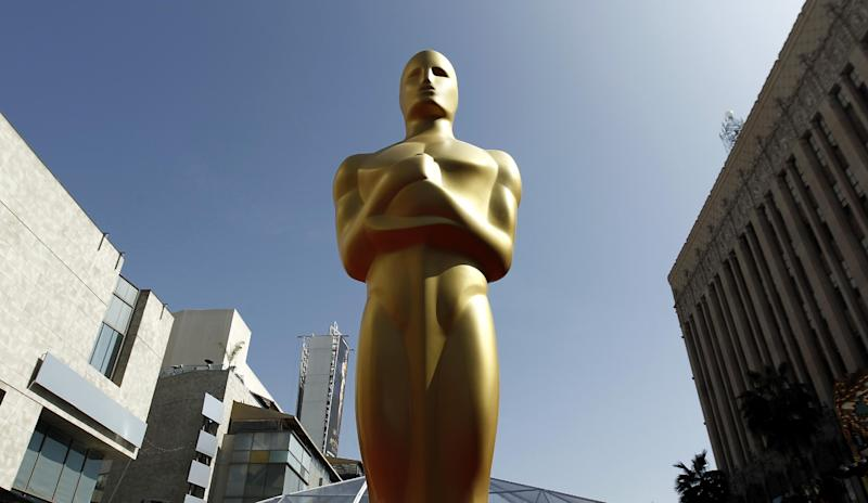 FILE - In this Feb. 26, 2012 file photo, an Oscar statue is seen on the red carpet before the 84th Academy Awards in Los Angeles. The Academy of Motion Picture Arts and Sciences says the golden statuette will visit at least 10 cities as part of its first national tour. Beginning Monday, Feb. 4, 2013, in New York City, the golden guy's journey will be chronicled online.  (AP Photo/Matt Sayles, File)