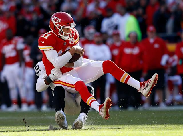 <p>Quarterback Alex Smith #11 of the Kansas City Chiefs is sacked by defensive end Khalil Mack #52 of the Oakland Raiders during the game at Arrowhead Stadium on December 10, 2017 in Kansas City, Missouri. (Photo by Jamie Squire/Getty Images) </p>