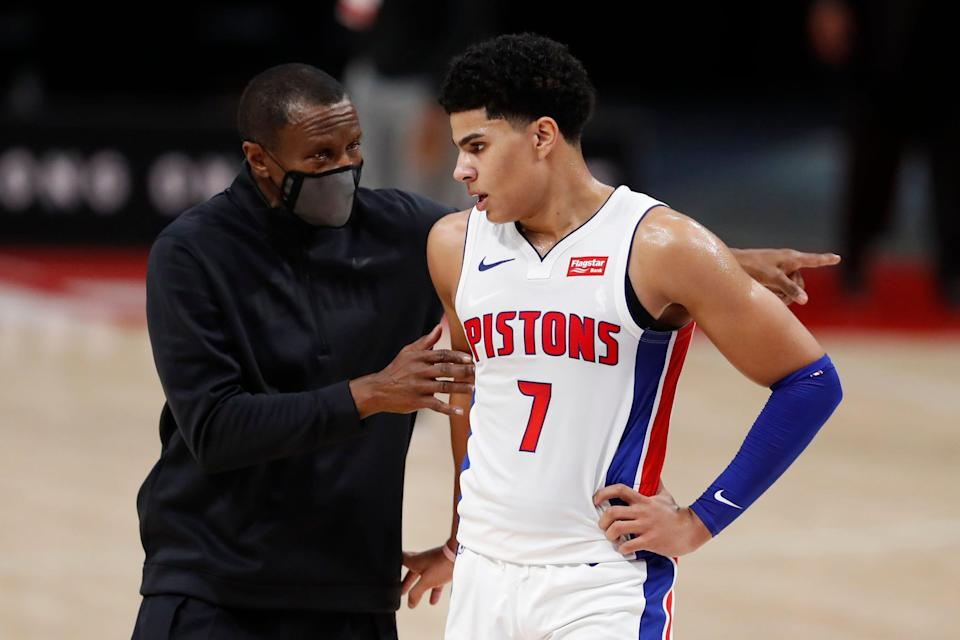 Detroit Pistons coach Dwane Casey talks with guard Killian Hayes during a preseason game Dec. 11, 2020, against the New York Knicks at Little Caesars Arena.