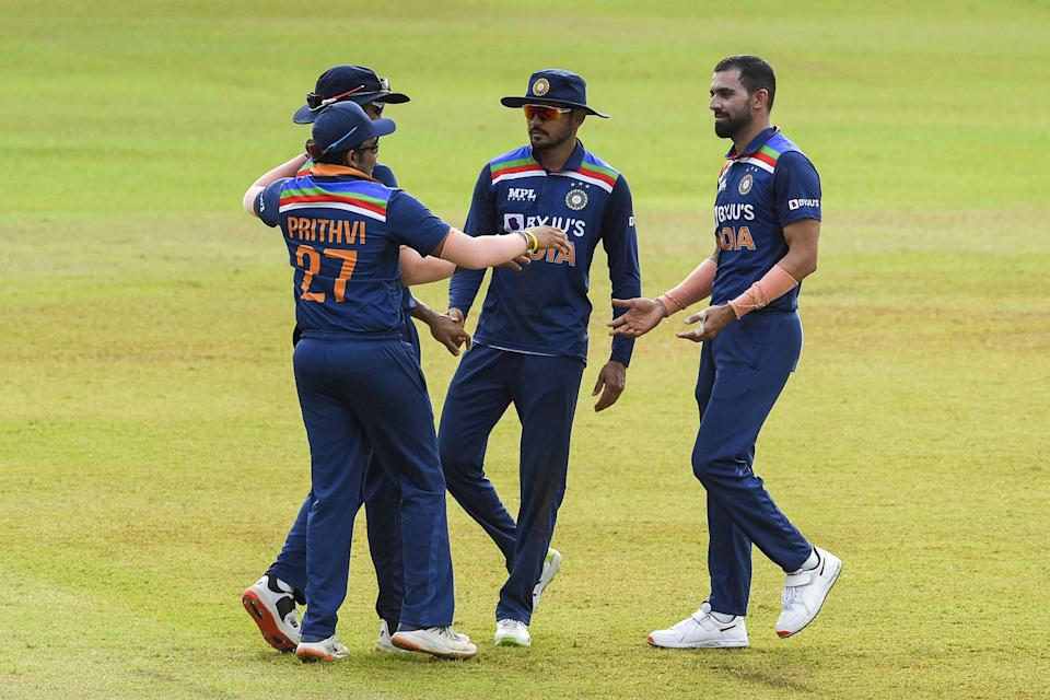 India's Deepak Chahar (R) celebrates with his teammate after the dismissal of Sri Lanka's Dhananjaya de Silva (not pictured) during the second one-day international (ODI) cricket match between Sri Lanka and India at the R.Premadasa Stadium in Colombo on July 20, 2021. (Photo by Ishara S. KODIKARA / AFP) (Photo by ISHARA S. KODIKARA/AFP via Getty Images)