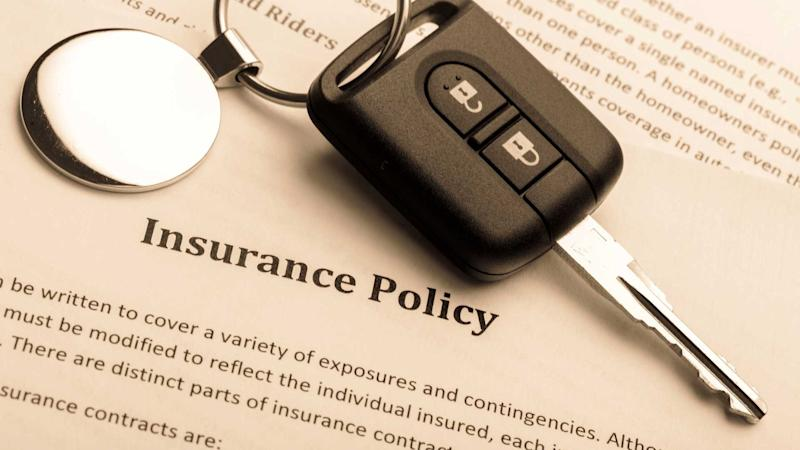 Insurance policy document with car key